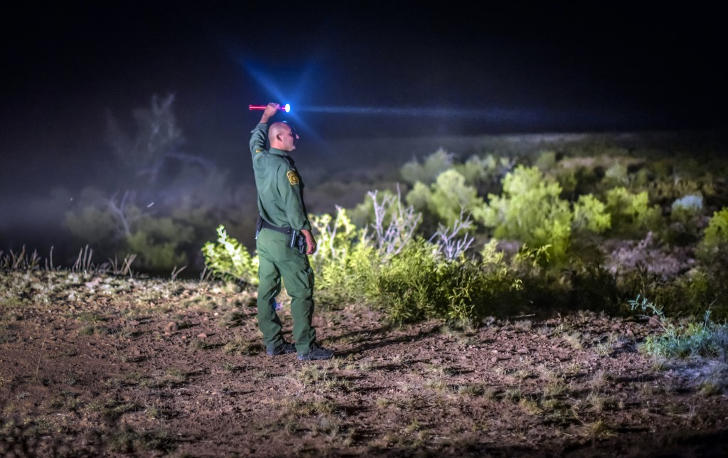 FILE - In this June 24, 2015, file photo, a Border Patrol agent looks for other agents in the Animas mountains in New Mexico's boot heel. A 7-year-old...