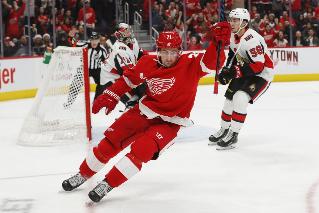 Detroit Red Wings center Dylan Larkin (71) celebrates his goal against Ottawa Senators goaltender Craig Anderson (41) in the second period of an NHL h...