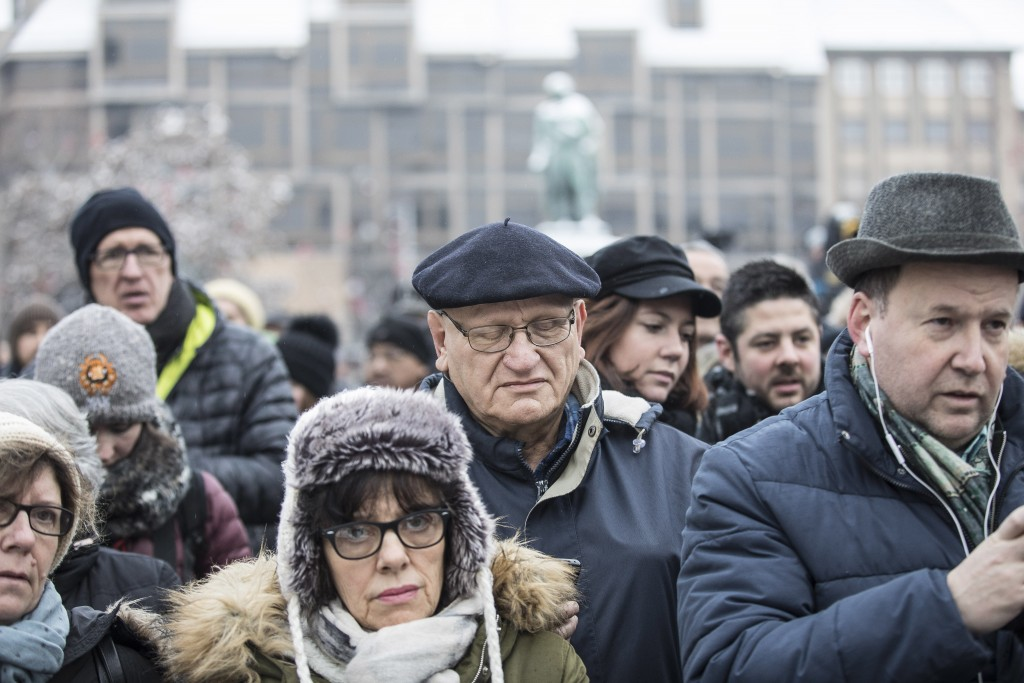Residents react during a gathering in a central square of the eastern French city of Strasbourg, Sunday Dec.16, 2018 to pay homage to the victims of a...