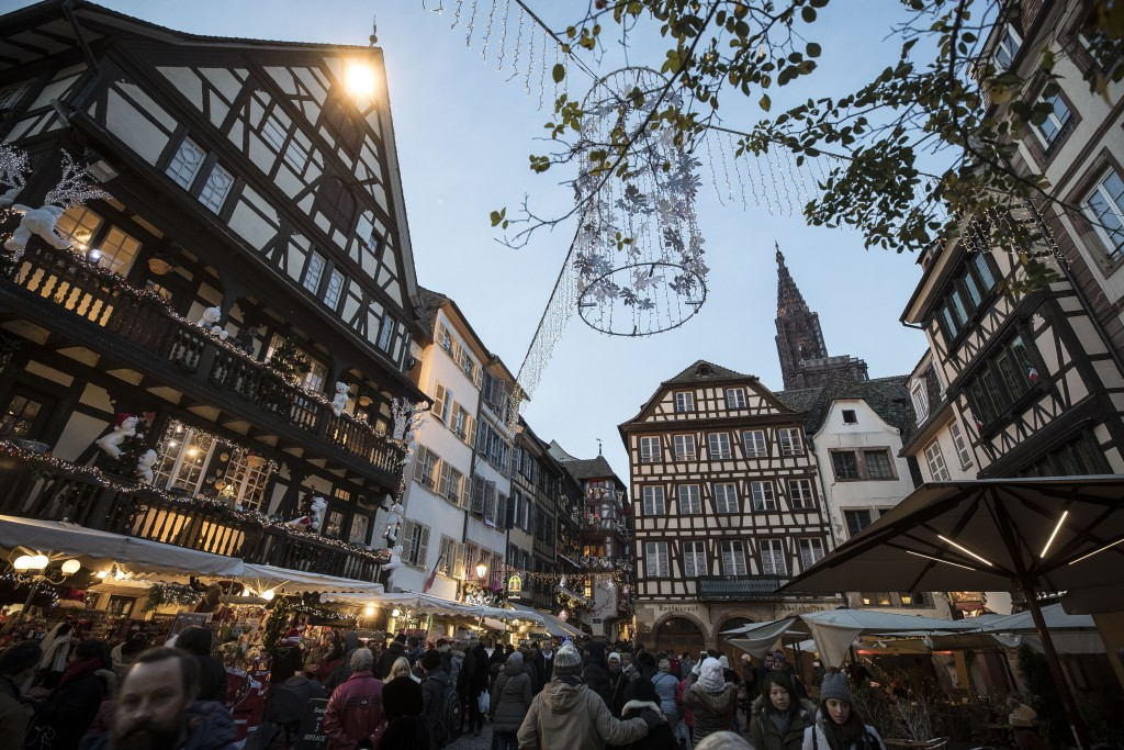People once against in the streets as Strasbourg's Christmas market reopens under the protection of police, in Strasbourg, France, Saturday Dec. 15, 2...