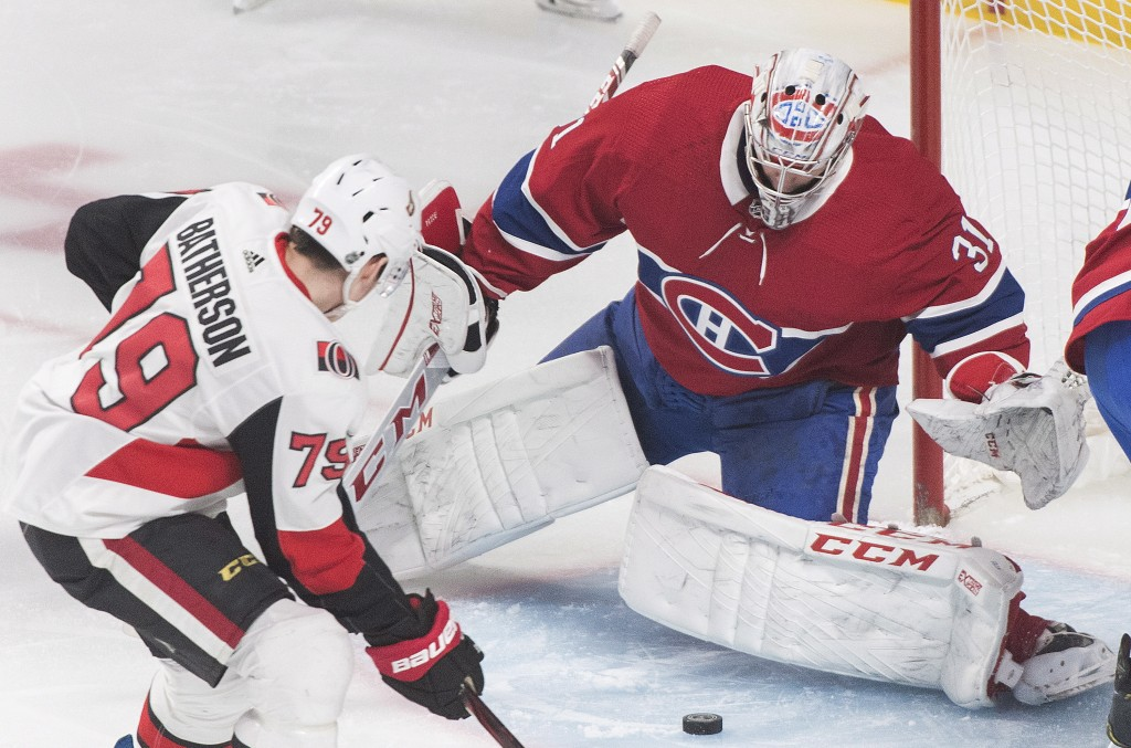 Ottawa Senators right wing Drake Batherson (79) is stopped by Montreal Canadiens goaltender Carey Price during first-period NHL hockey game action in ...