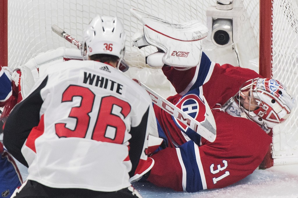 Ottawa Senators center Colin White (36) scores against Montreal Canadiens goaltender Carey Price during first-period NHL hockey game action in Montrea...