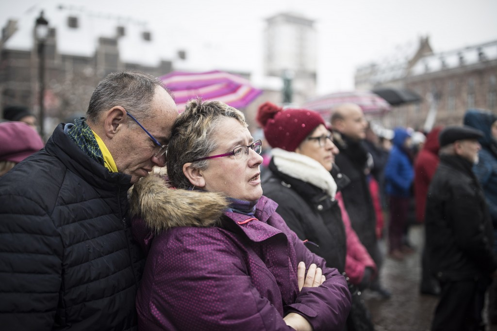 Residents react during gathering being held in a central square of the eastern French city of Strasbourg, Sunday Dec.16, 2018 to pay homage to the vic...