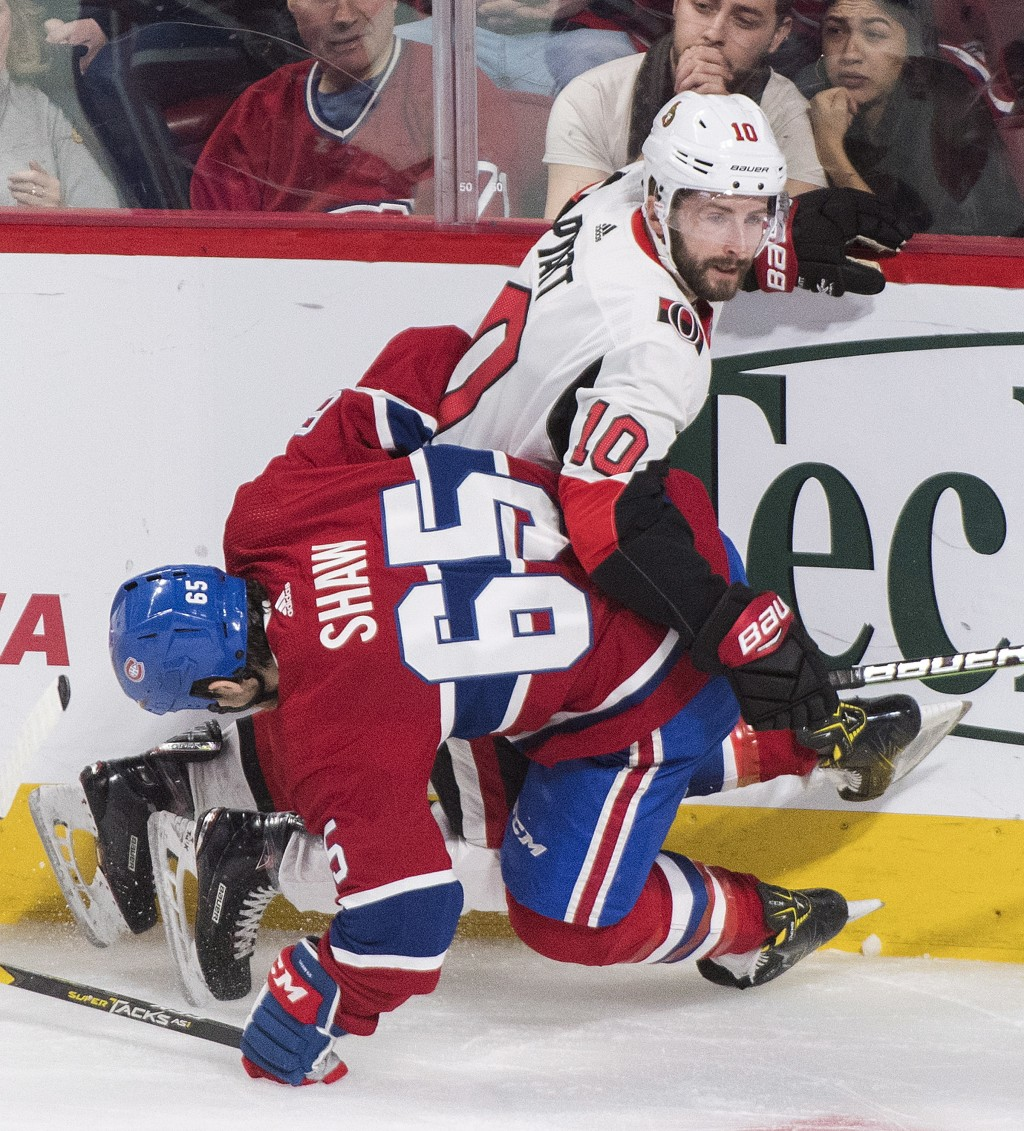 Montreal Canadiens right wing Andrew Shaw (65) collides with Ottawa Senators left wing Tom Pyatt (10) during first-period NHL hockey game action in Mo...