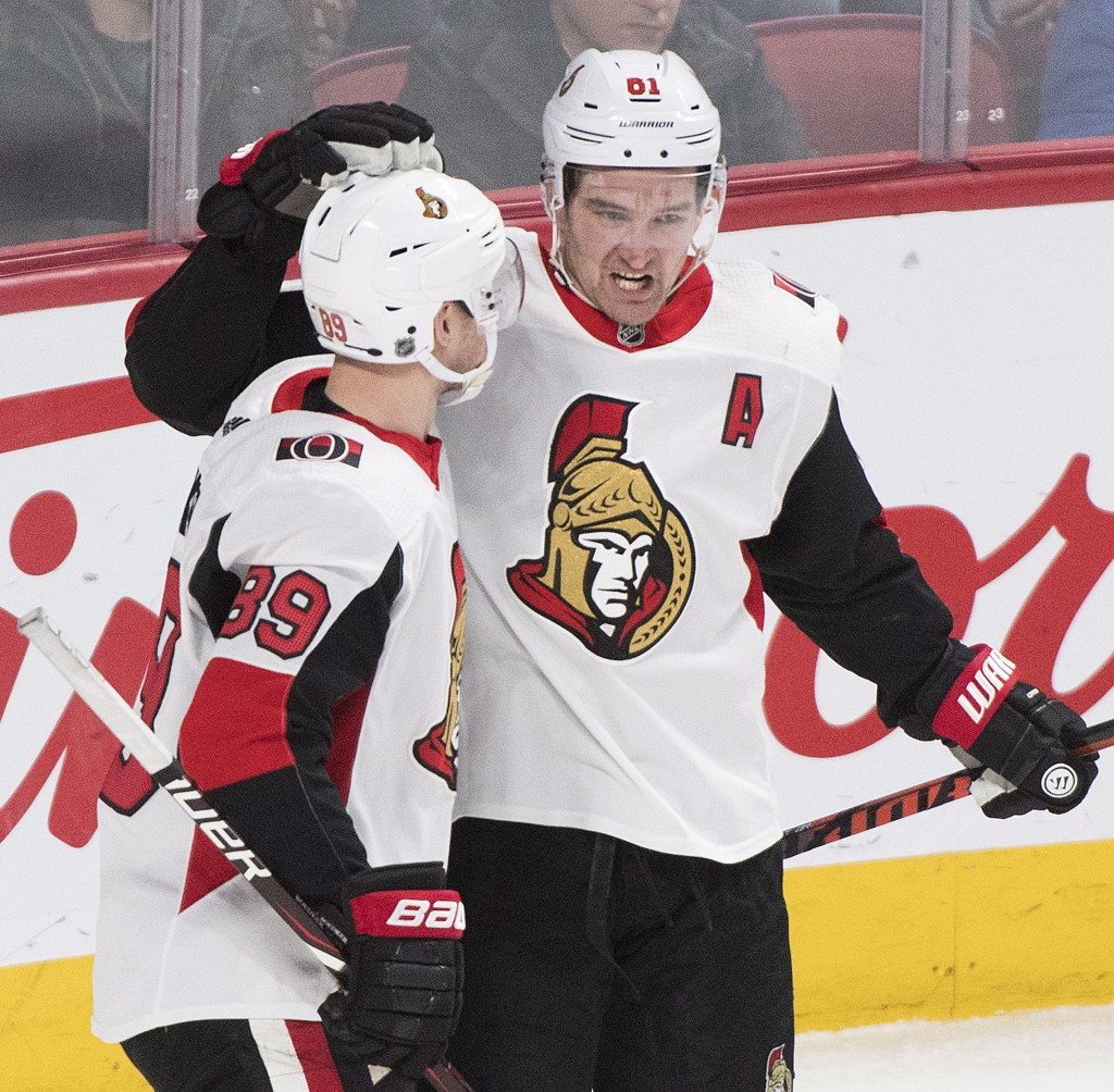 Ottawa Senators left wing Mikkel Boedker (89) celebrates with teammate Mark Stone after scoring against the Montreal Canadiens during second-period NH...