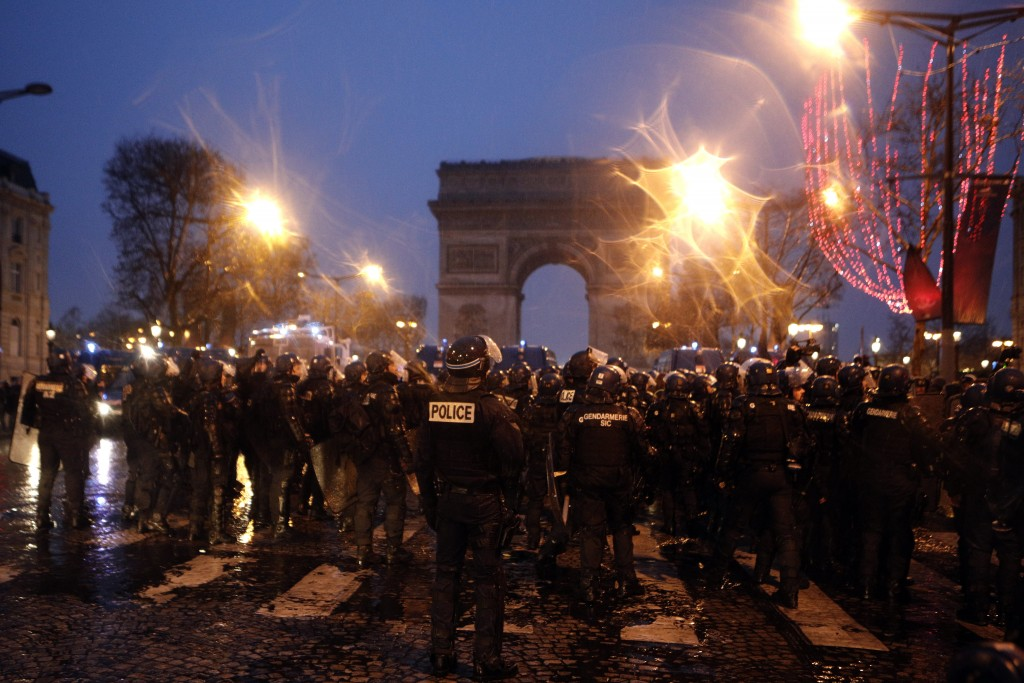 Police forces secure the Champs-Elysees avenue, Saturday, Dec. 15, 2018 in Paris. The demonstrations against France's high cost of living _ sapped by ...
