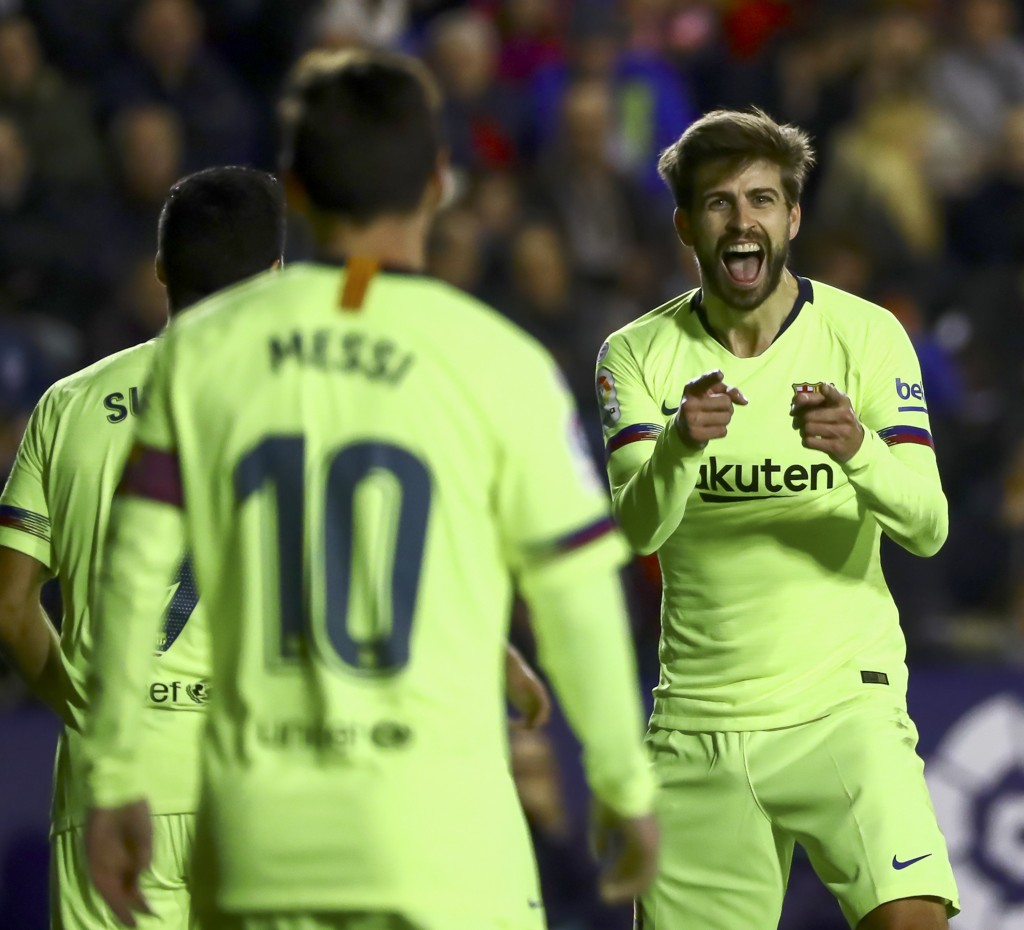 FC Barcelona's defender Gerard Pique, right, celebrates after scoring the 0-5 goal with his teammate Leo Messi during their La Liga soccer match betwe...