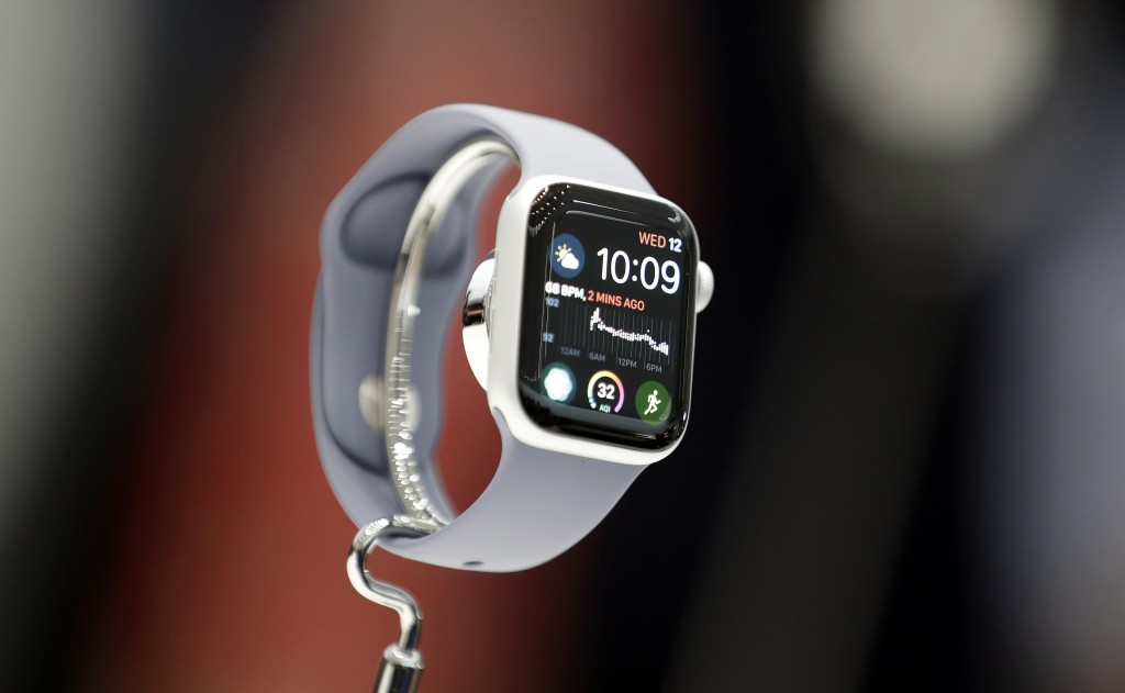 FILE - In this Sept. 12, 2018, file photo the new Apple Watch 4 is on display at the Steve Jobs Theater during an event to announce new products in Cu...