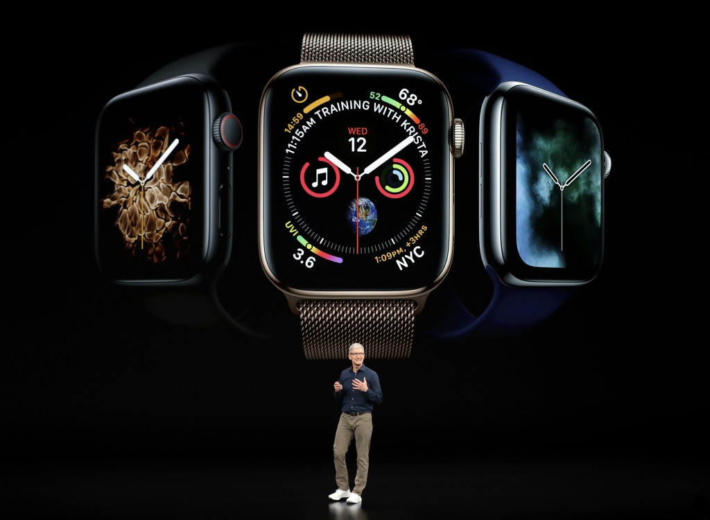 FILE- In this Sept. 12, 2018, file photo Apple CEO Tim Cook discusses the new Apple Watch 4 at the Steve Jobs Theater during an event to announce new