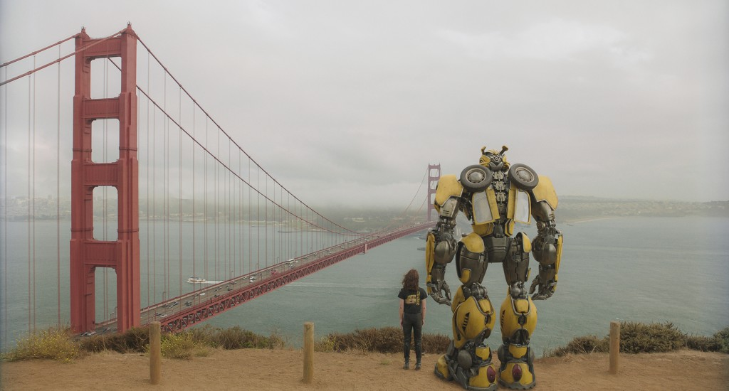 "This image released by Paramount Pictures shows Hailee Steinfeld as Charlie with Bumblebee in a scene from ""Bumblebee."" (Paramount Pictures via AP)"