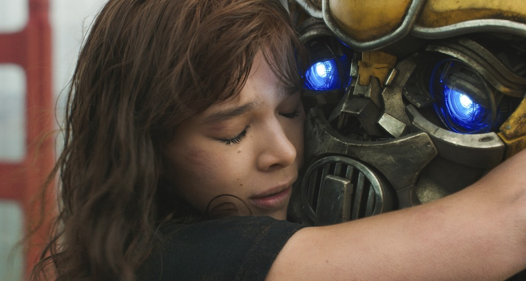 """This image released by Paramount Pictures shows Hailee Steinfeld as Charlie and Bumblebee in a scene from """"Bumblebee."""" (Will McCoy/Paramount Pictures ..."""