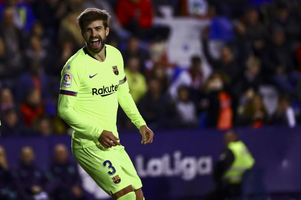 FC Barcelona's defender Gerard Pique celebrates after scoring a goal during their La Liga soccer match between Levante UD and FC Barcelona at Ciutat d...