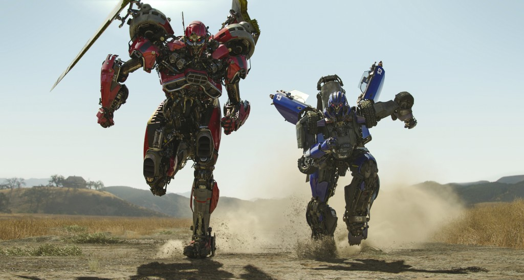 "This image released by Paramount Pictures shows  Shatter, left, and Dropkick in a scene from ""Bumblebee."" (Paramount Pictures via AP)"