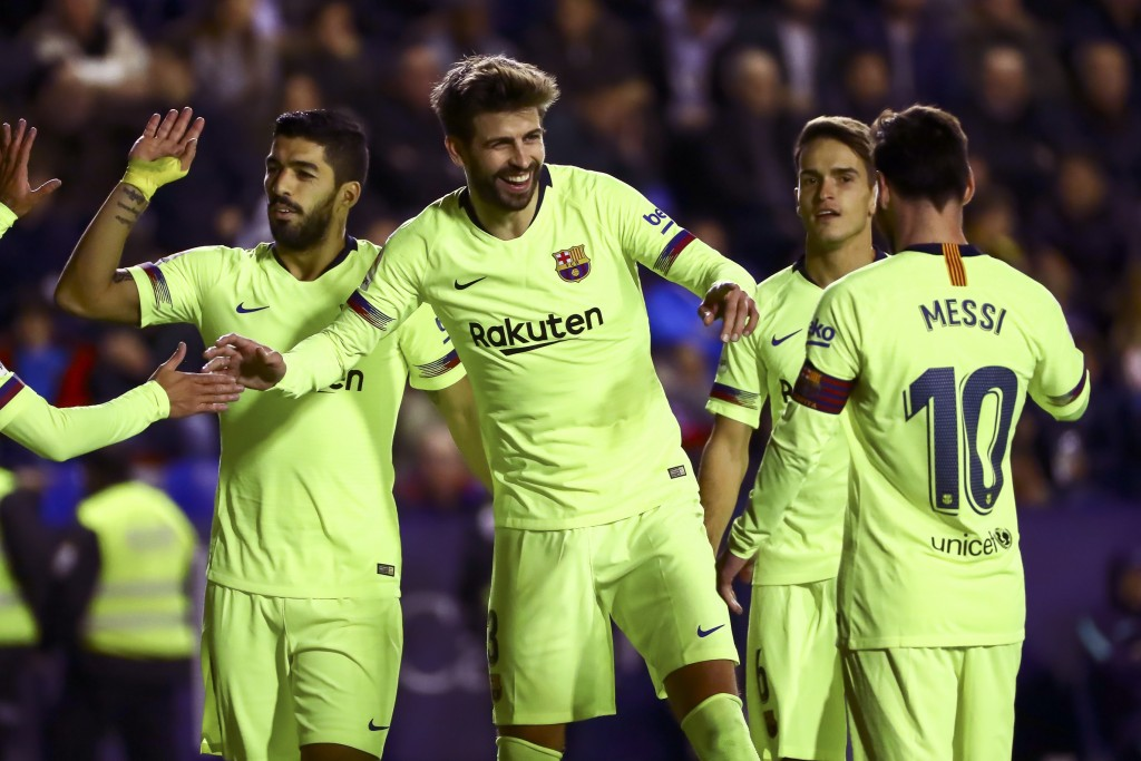 FC Barcelona's defender Gerard Pique, center, celebrate after scoring the 0-5, goal with his teammate FC Barcelona's forward Luis Suarez, left, and FC...