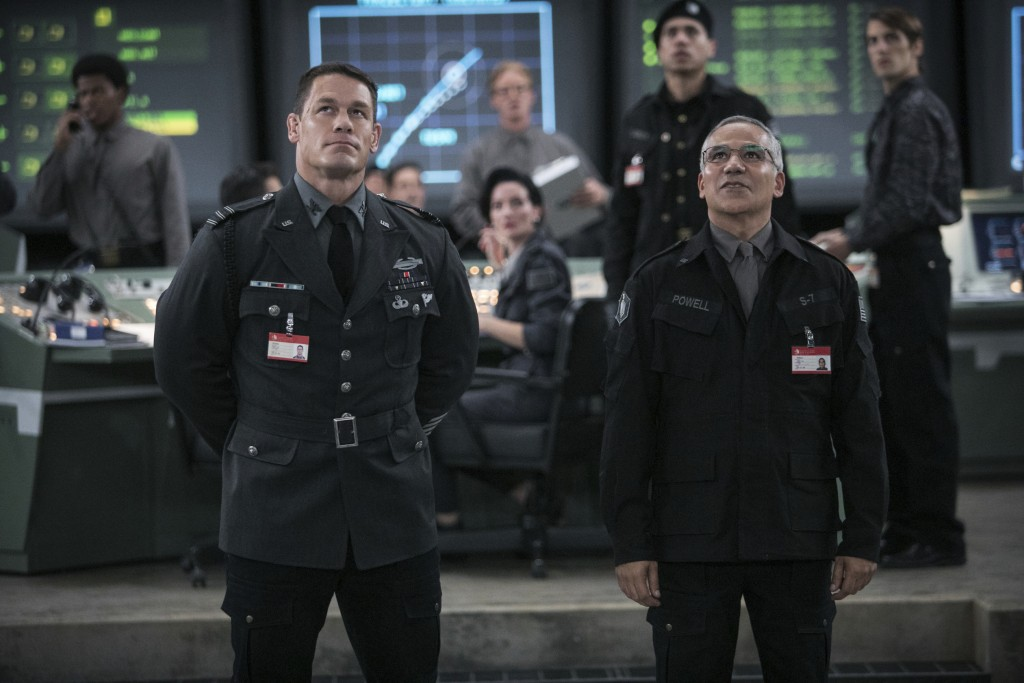 """This image released by Paramount Pictures shows  John Cena as Agent Burns, left, and John Ortiz as Dr. Powell in a scene from """"Bumblebee."""" (Jaime True..."""