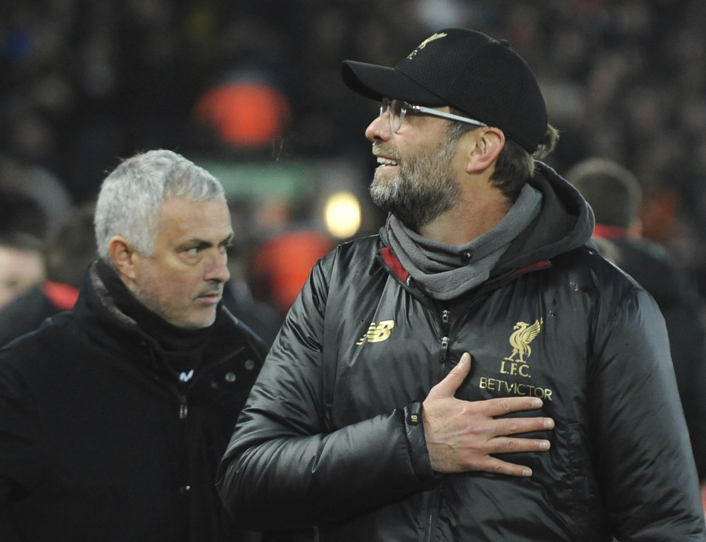 Liverpool manager Juergen Klopp, right, and Manchester United manager Jose Mourinho seen prior to the English Premier League soccer match between Live...