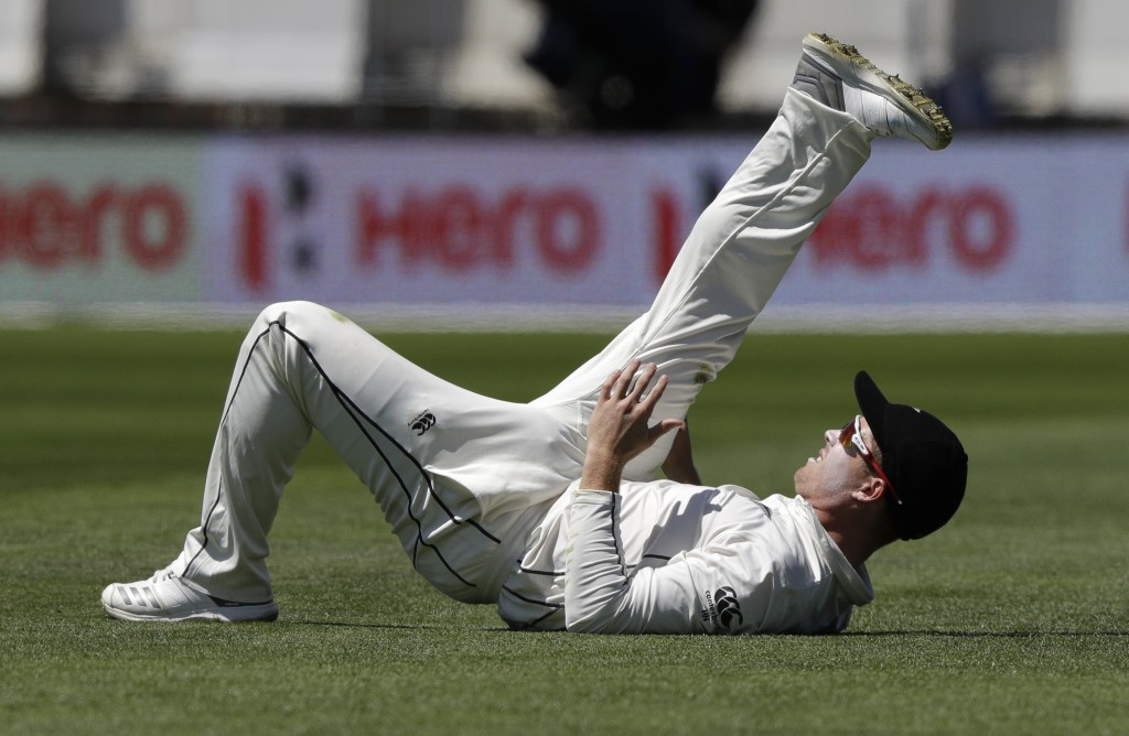 1b001a86 New Zealand's Henry Nicholls stretches during play on day four of the first  cricket test between