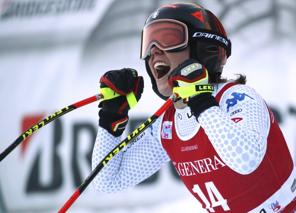 Italy's Nicol Delago celebrates at the finish area during a ski World Cup Women's Downhill, in Val Gardena, Italy, Tuesday, Dec. 18, 2018. (AP Photo/A...