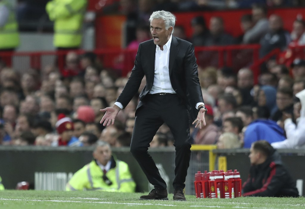 FILE - In this Friday, Aug. 10, 2018 file photo Manchester United's manager Jose Mourinho reacts in frustration during the English Premier League socc...