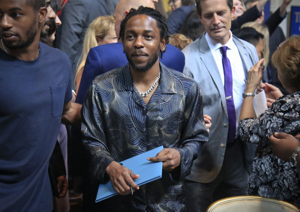 """FILE - In this May 30, 2018 file photo, Kendrick Lamar holds a certificate after winning the Pulitzer Prize for music for his album """"DAMN,"""" during the..."""