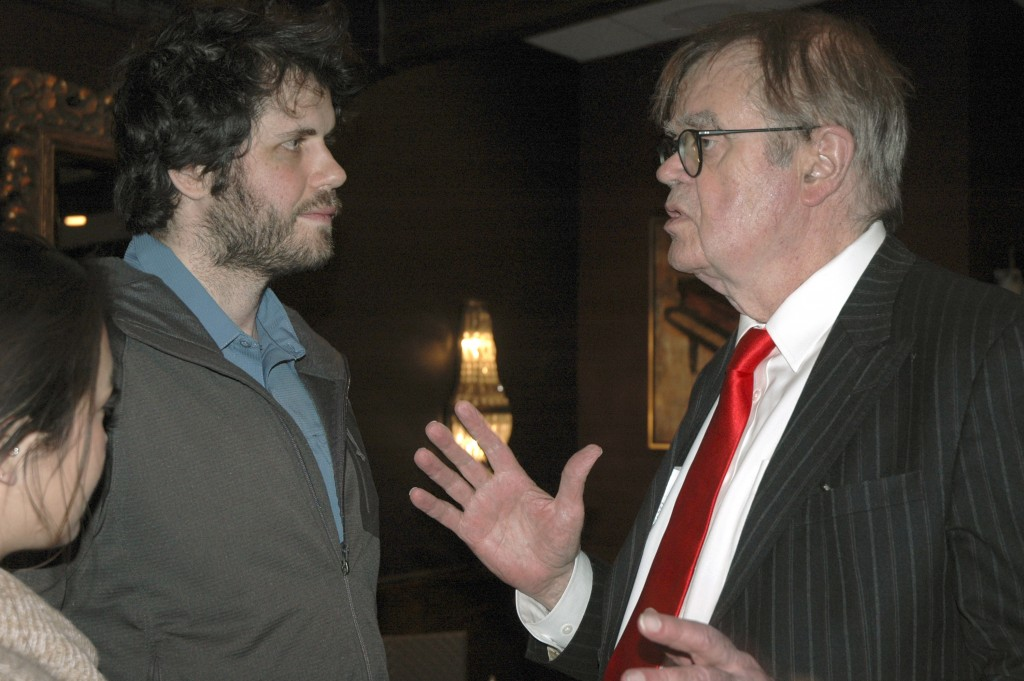 """In this Sunday, Dec. 16, 2018, former """"A Prairie Home Companion"""" host Garrison Keillor, right, talks to fans after his performances at Crooners lounge..."""