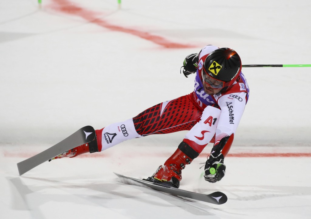Austria's Marcel Hirscher speeds down the course during a ski World Cup men's Parallel Giant Slalom, in Alta Badia, Italy, Monday, Dec. 17, 2018. (AP ...