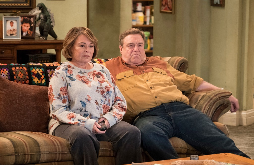 "In this image released by ABC, Roseanne Barr, left, and John Goodman appear in a scene from the comedy series ""Roseanne."" The comedy about the blue-co"