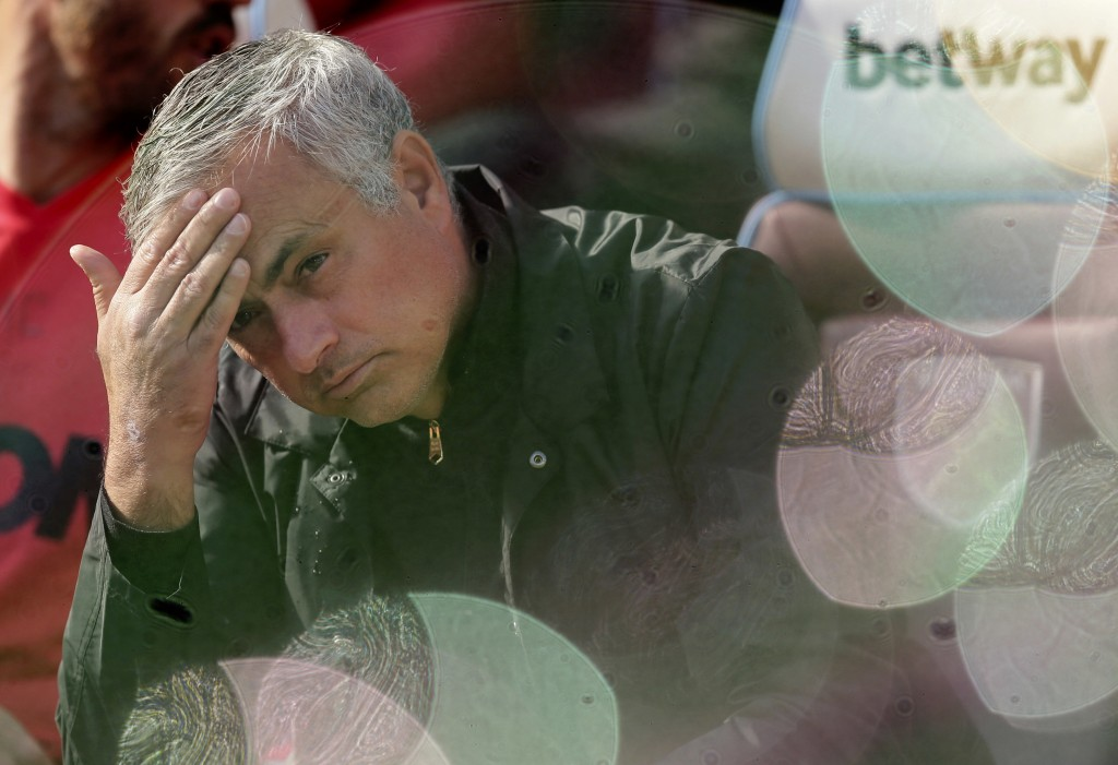 FILE - In this Saturday, Sept. 29, 2018 file photo Manchester United manager Jose Mourinho, seen through foam bubbles, wipes his forehead prior the En