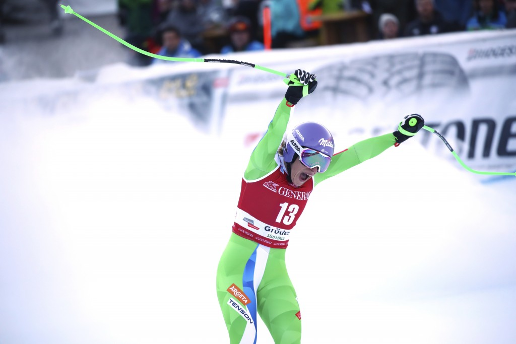 Slovenia's Ilka Stuhec celebrates at the finish area during a ski World Cup Women's Downhill, in Val Gardena, Italy, Tuesday, Dec. 18, 2018. (AP Photo