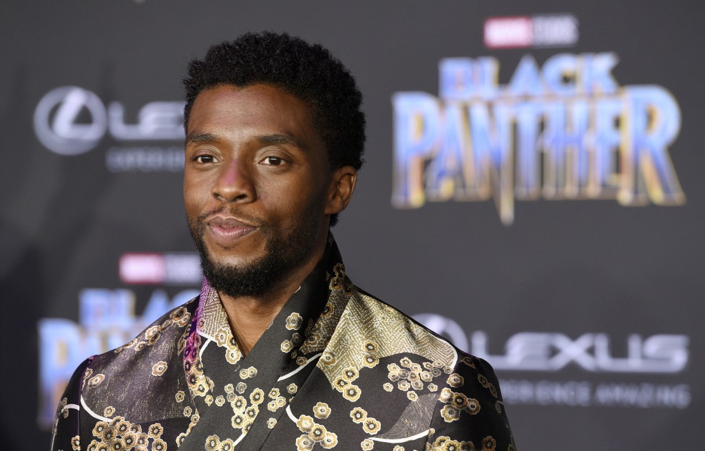 """FILE - In this Jan. 29, 2018 file photo, Chadwick Boseman, a cast member in """"Black Panther,"""" poses at the premiere of the film in Los Angeles. The box..."""