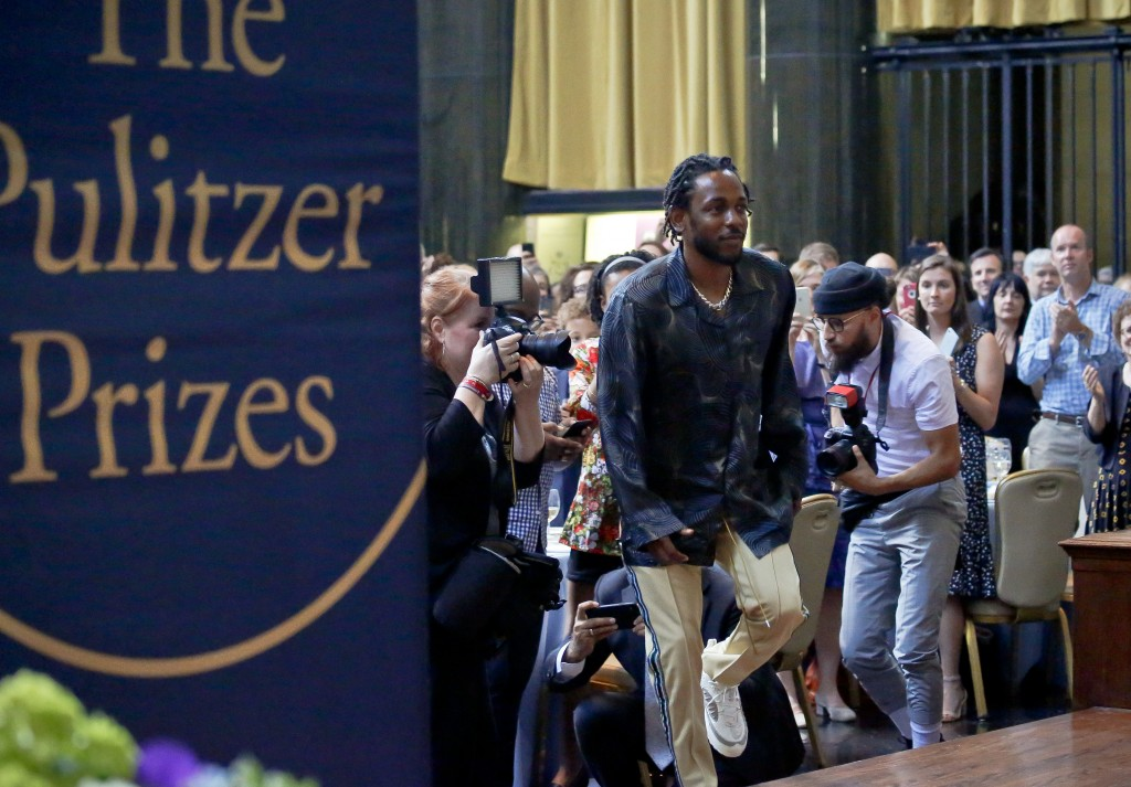 """FILE - In this May 30, 2018 file photo, Kendrick Lamar walks onto the stage to accept the Pulitzer Prize for music for his album """"DAMN,"""" during the 20..."""