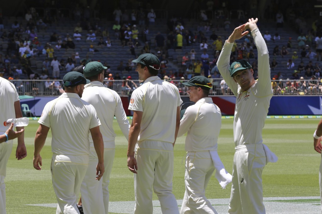 Australia's Peter Handscomb waves to the crowd as the Australian players walk off the ground following their win in the second cricket test between Au