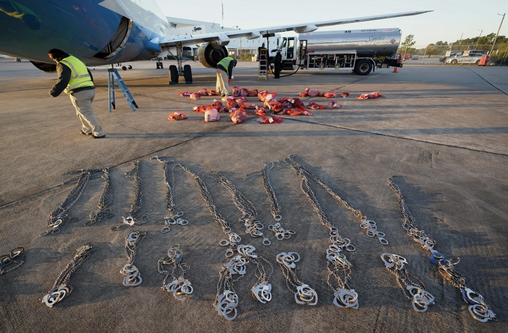 In this Nov. 16, 2018, photo, personal belongings of immigrants who entered the United States illegally are loaded onto a plane for a deportation flig...