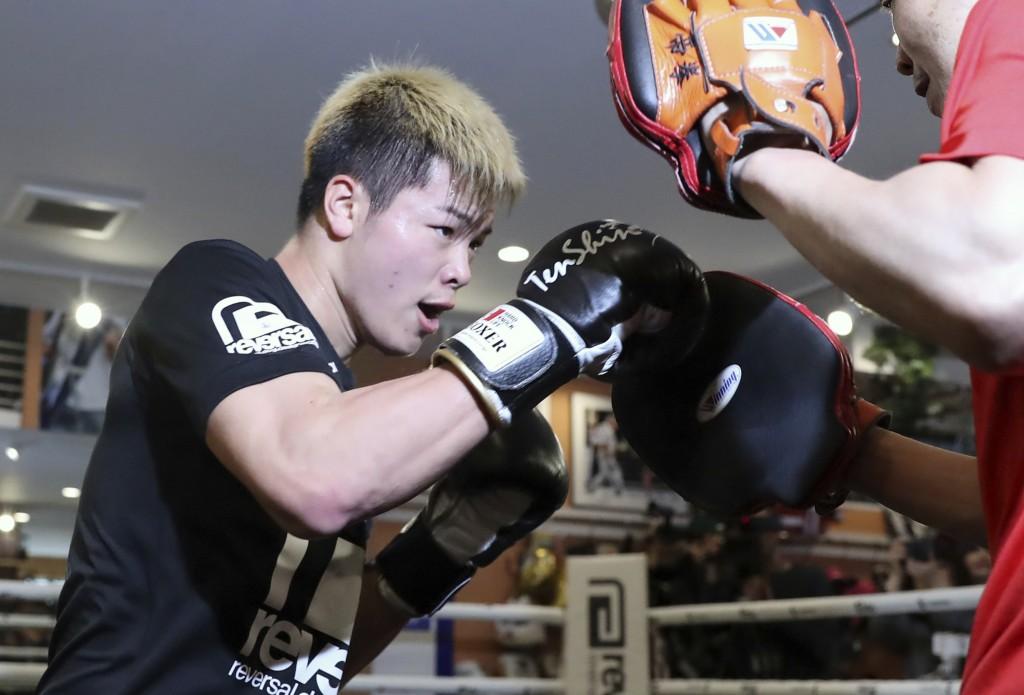 Japanese kickboxer Tenshin Nasukawa warms up at his gym in Matsudo, northwest of Tokyo Tuesday, Dec. 18, 2018. Nasukawa is scheduled to face Floyd May
