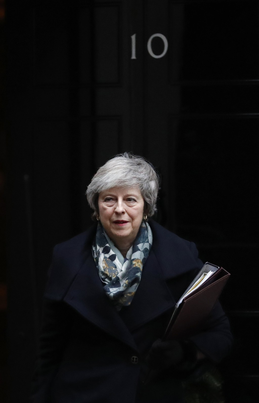 Britain's Prime Minister Theresa May leaves 10 Downing Street, in London Monday, Dec. 17, 2018, for the House of Commons to make a statement on the EU...