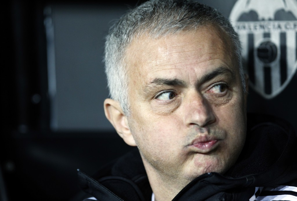 FILE - In this Wednesday, Dec. 12, 2018 file photo Manchester United coach Jose Mourinho looks out from the bench prior a Group H Champions League soc