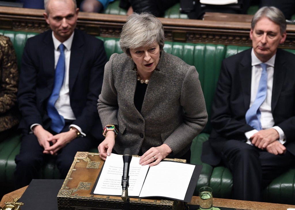 In this photo provided by the UK Parliament, Britain's Prime Minister Theresa May delivers a speech in the House of Commons in London, Monday, Dec. 17...