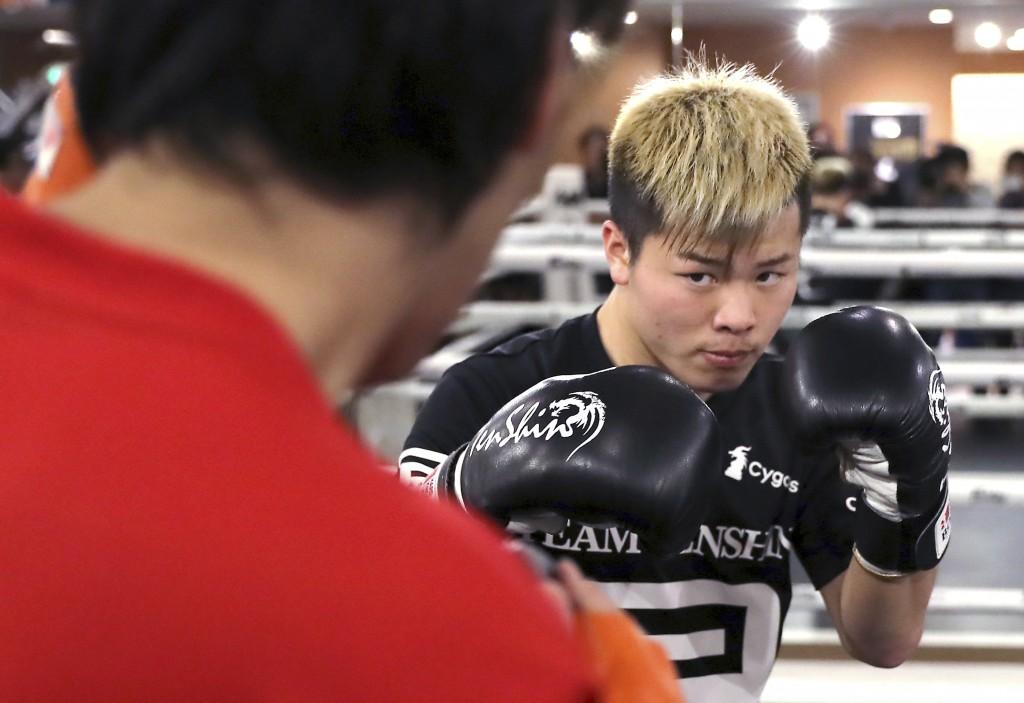 Japanese kickboxer Tenshin Nasukawa warms up at his gym in Matsudo, northwest of Tokyo Tuesday, Dec. 18, 2018. Nasukawa is scheduled to face Floyd May...
