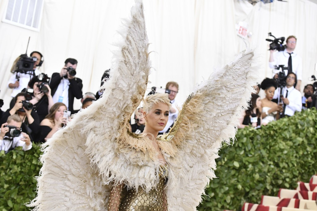 FILE - In this May 7, 2018 file photo, singer Katy Perry wears angel wings at The Metropolitan Museum of Art's Costume Institute benefit gala celebrat