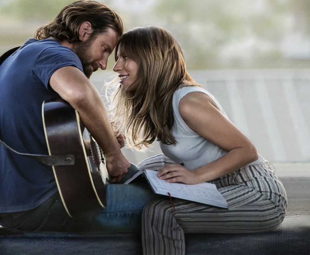"""This image released by Warner Bros. Pictures shows Bradley Cooper, left, and Lady Gaga in a scene from """"A Star is Born.""""  (Warner Bros. Pictures via A..."""