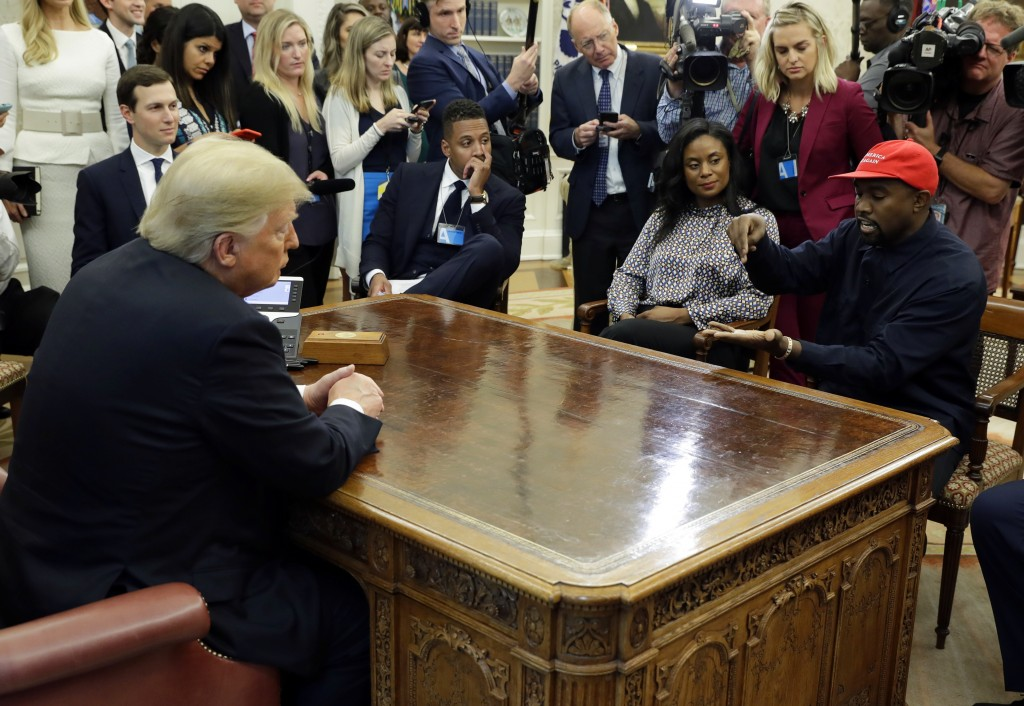 FILE - In this Oct. 11, 2018 file photo, rapper Kanye West speaks to President Donald Trump and others in the Oval Office of the White House in Washin...