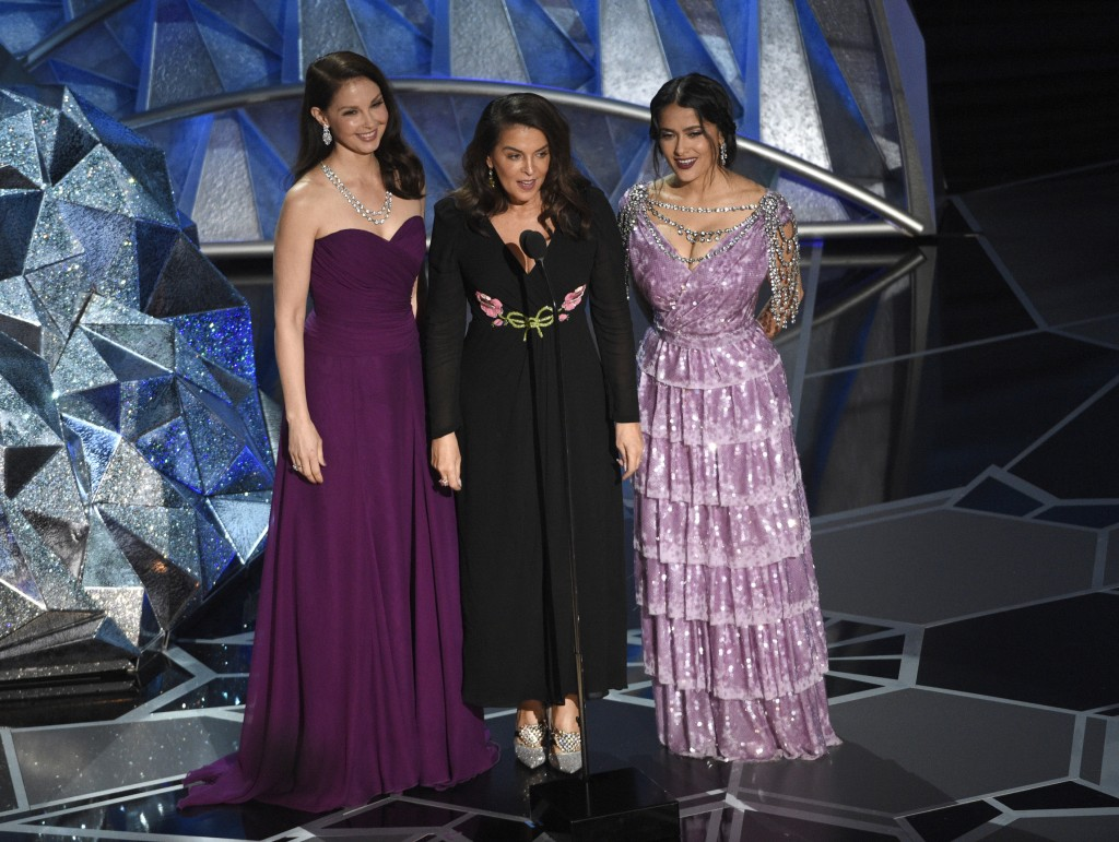 FILE - In this March 4, 2018 file photo, Harvey Weinstein accusers, Ashley Judd, from left, Annabella Sciorra and Salma Hayek speak at the Oscars in L