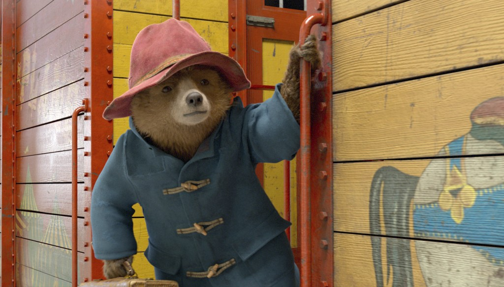 """This image released by Warner Bros. Pictures shows the character Paddington, voiced by Ben Whishaw, in a scene from """"Paddington 2.""""  (Warner Bros. Pic..."""