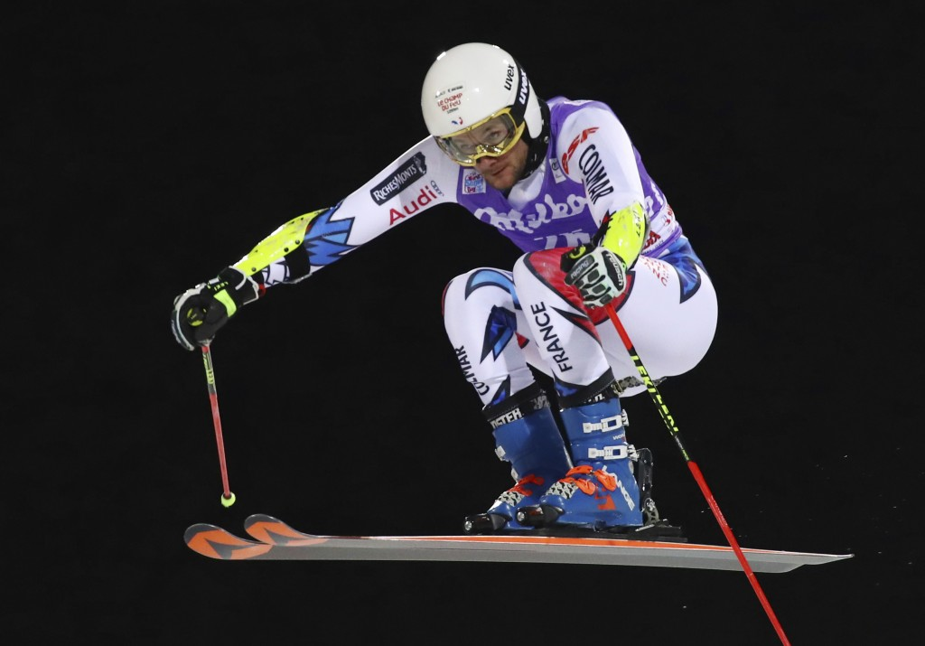 France's Thibaut Favrot speeds down the course during a ski World Cup men's Parallel Giant Slalom, in Alta Badia, Italy, Monday, Dec. 17, 2018. (AP Ph