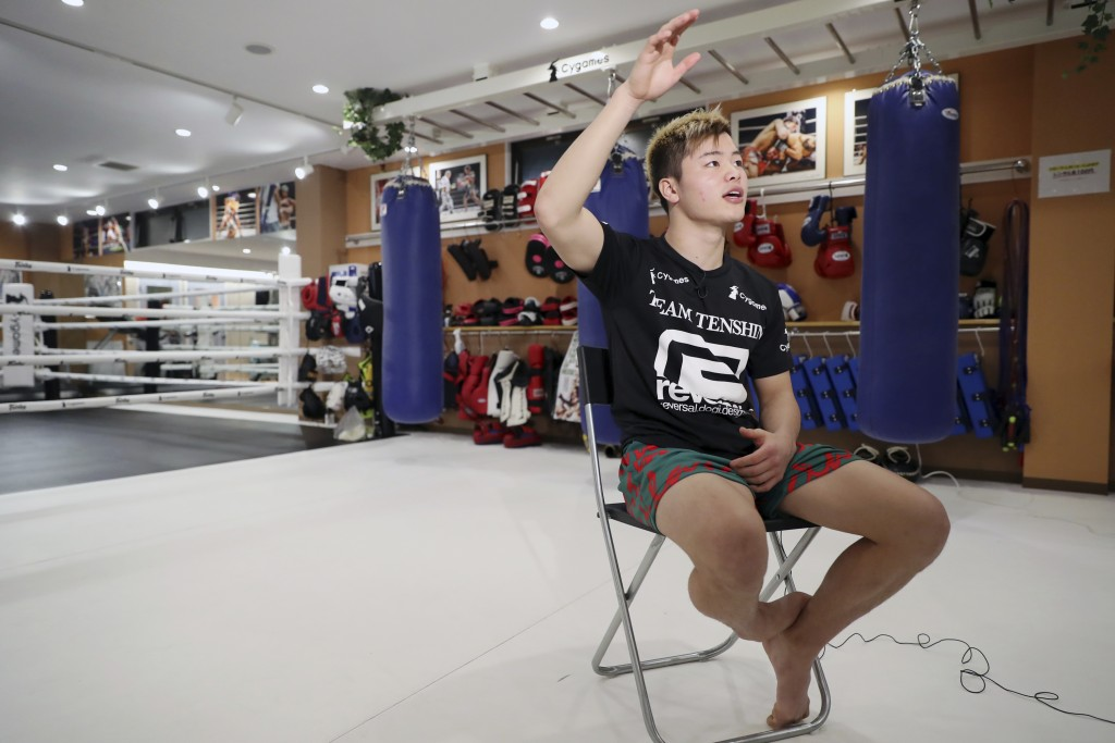 Japanese kickboxer Tenshin Nasukawa speaks during an exclusive interview with the Associated Press at his gym in Matsudo, northwest of Tokyo Tuesday, ...