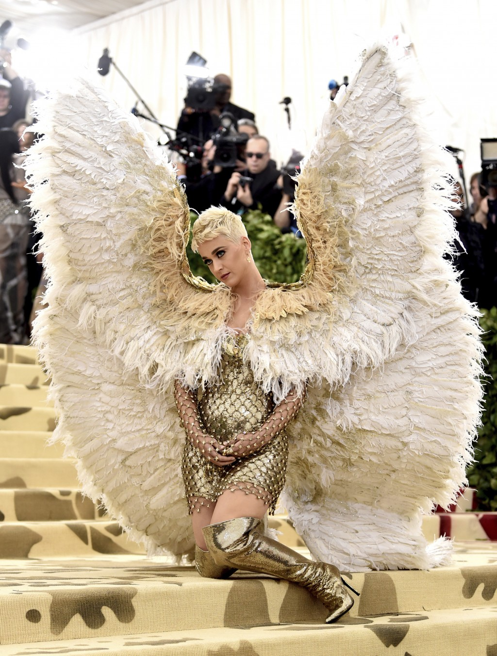 FILE - In this May 7, 2018 file photo, singer Katy Perry wears angel wings at The Metropolitan Museum of Art's Costume Institute benefit gala celebrat...