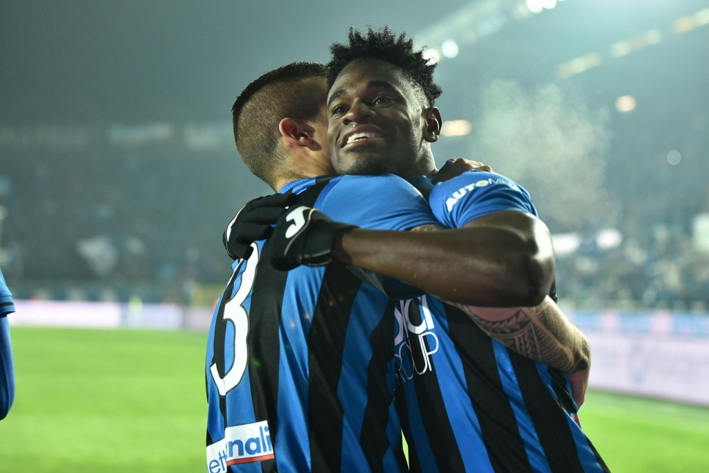 Atalanta's Duvan Zapata, right, is embraced by a teammate after scoring his team's opening goal during the Italian Serie A soccer match between Atalan