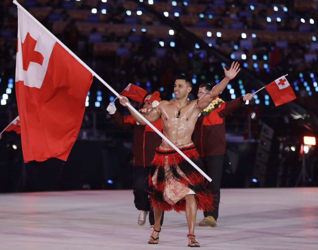 Pita Taufatofua carries the flag of Tonga during the opening ceremony of the 2018 Winter Olympics in Pyeongchang, South Korea, Friday, Feb. 9, 2018. (...