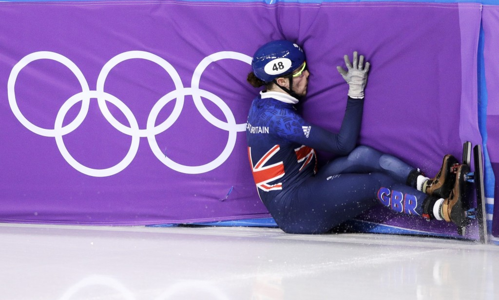 Farrell Treacy of Great Britain crashes during the men's 1500 meters in the Gangneung Ice Arena at the 2018 Winter Olympics in Gangneung, South Korea,...