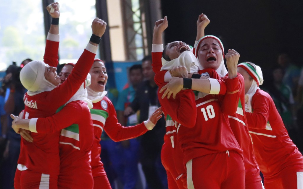 Iran's team, in red, react after defeating India's during at the women's team Kabaddi gold medal match at the 18th Asian Games in Jakarta, Indonesia, ...